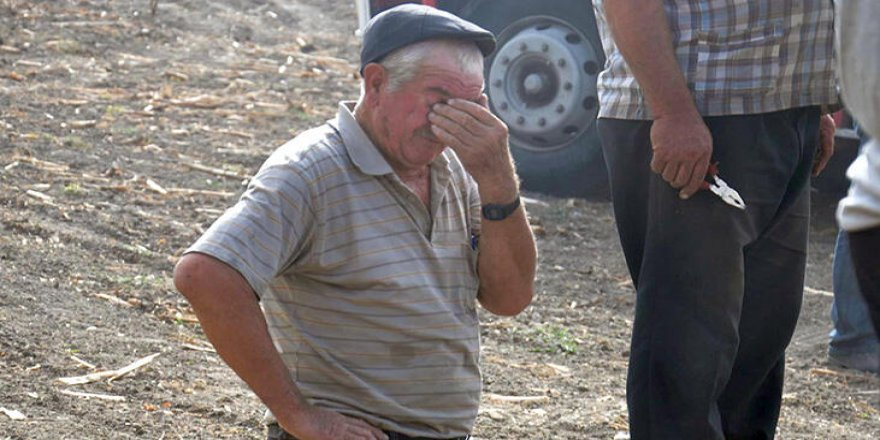 Ürünlerinin yanmasını gözyaşları dökerek izledi