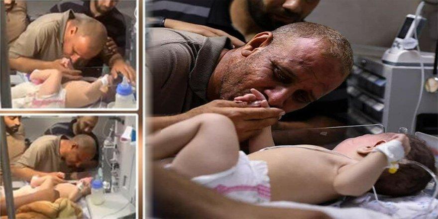 İsrail'inhava saldırısında eşi ve 3 çocuğunu kaybedenFilistinli babanın, 2 aylık yaralı bebeğiyle buluştuğu o an