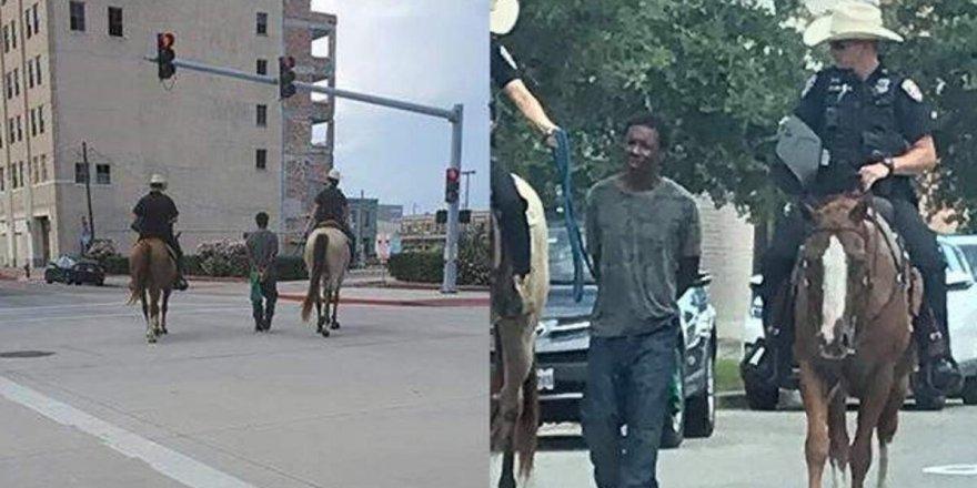 ABD'de atlı polislerin kelepçeyle arkalarında yürüttüğü siyahi adamdan 1 milyon dolarlık dava