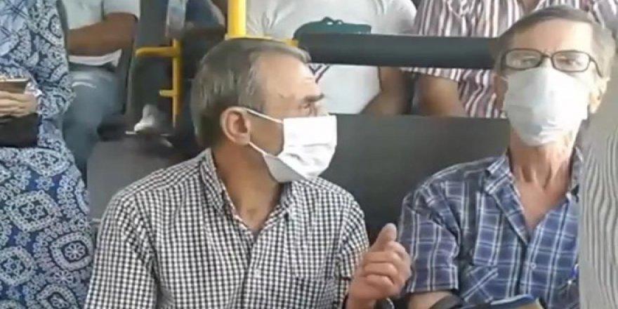 Otobüste sosyal mesafe tartışması, zorla kaldırmaya çalıştı